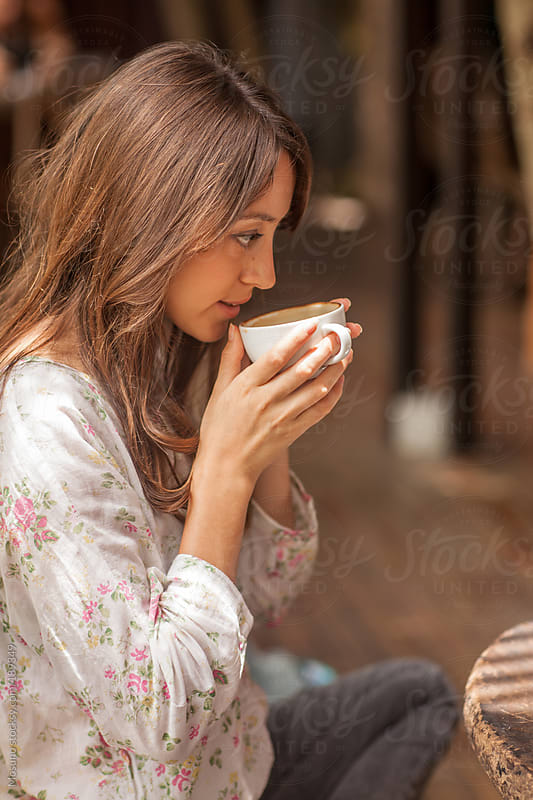 Woman Having Coffee by Mosuno for Stocksy United