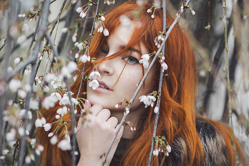 Beautiful redhead with freckles by Maja Topcagic for Stocksy United