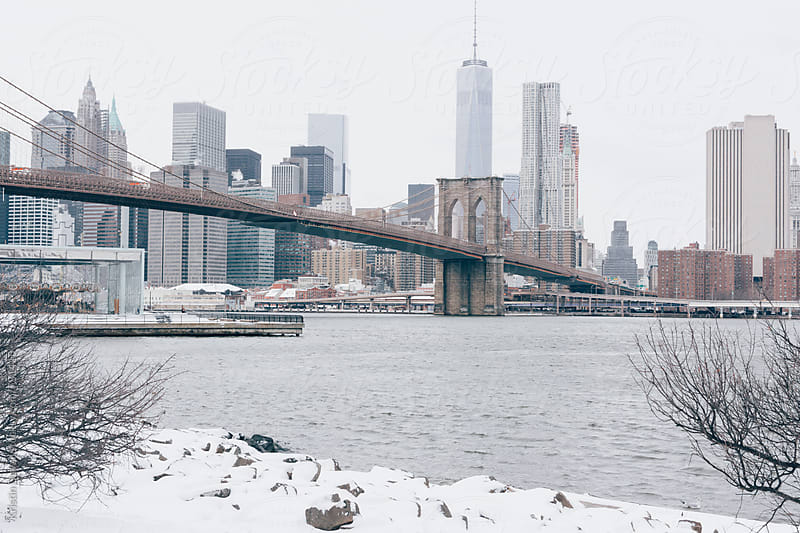 Winter view of Brooklyn Bridge with Manhattan skyline. New York City. by Kristin Duvall for Stocksy United