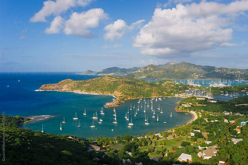 West Indies, Caribbean, Lesser Antilles, Leeward Islands, Antigua and Barbuda, Antigua, elevated view of English Harbour from Shirley Heights looking towards Nelson's Dockyard by Gavin Hellier for Stocksy United