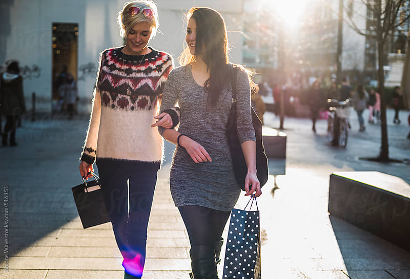Women friends walking in the city during shopping by GIC for Stocksy United