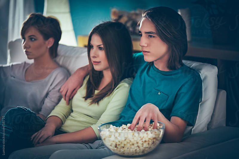 Teenagers Watching a Movie by Lumina for Stocksy United