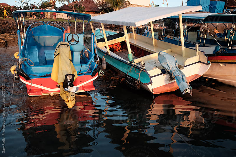 Boats Reflected in Balinese Inlet by Gary Radler Photography for Stocksy United