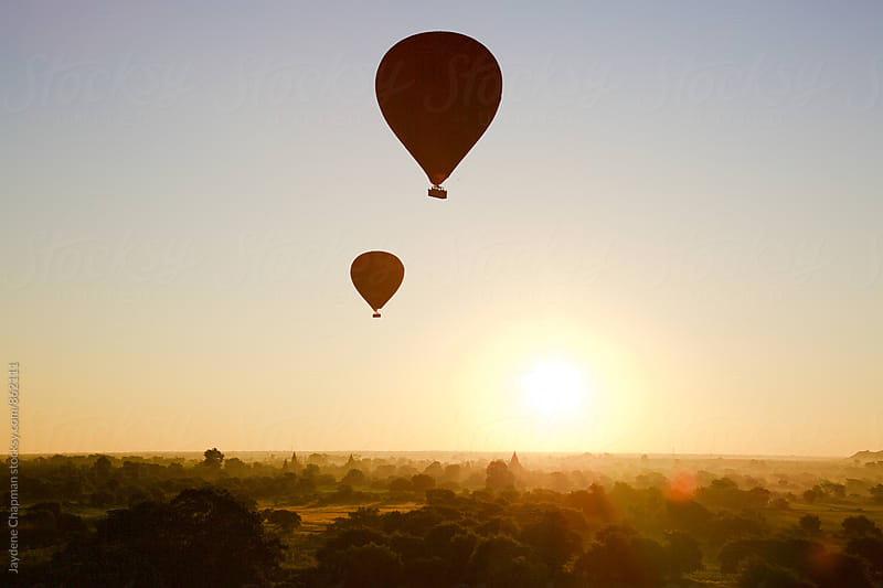Magical balloons over Bagan with silhouettes of strangers by Jaydene Chapman for Stocksy United