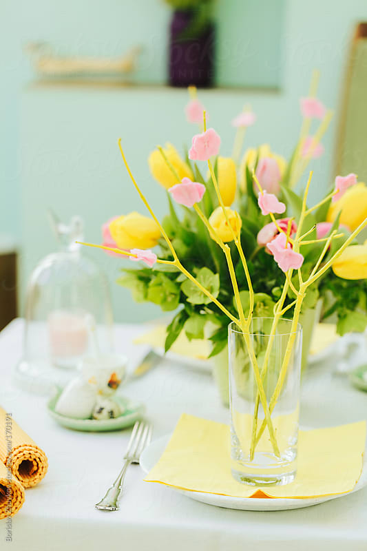Beautifully decorated table with flowers for Easter  by Borislav Zhuykov for Stocksy United