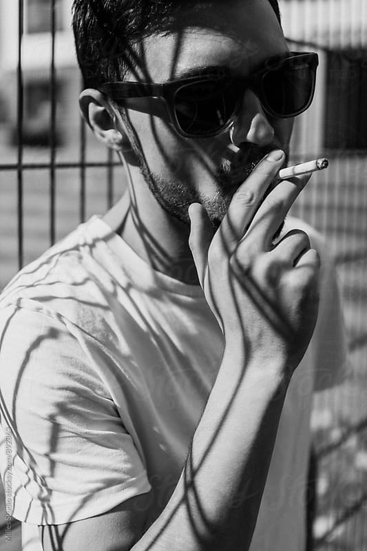 Man smoking outside by Milles Studio for Stocksy United