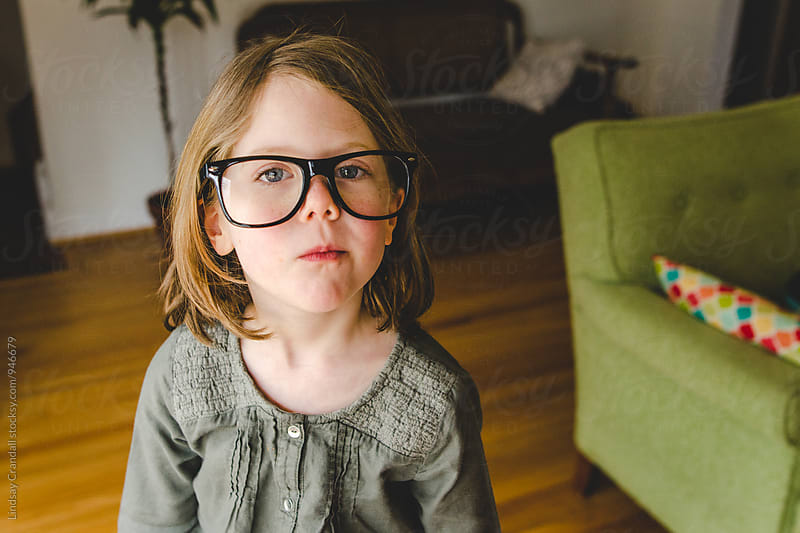Little girl in oversized hipster glasses by Lindsay Crandall for Stocksy United