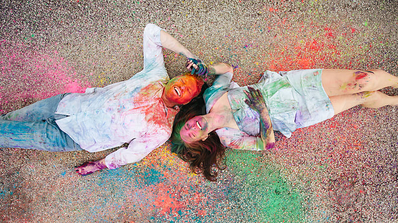 couple in colorful mess by Brian Powell for Stocksy United