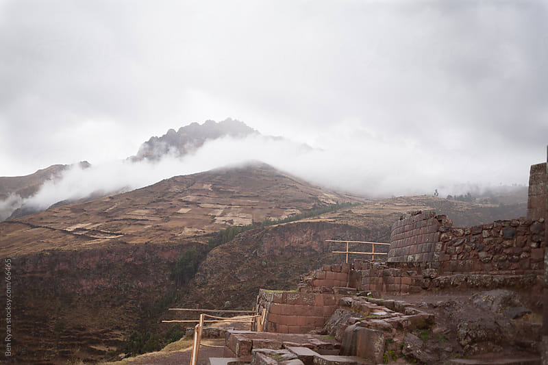 Peru: Incan ruins at Pisaq and mist covered mountains by Ben Ryan for Stocksy United