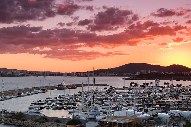 Vibrant sunset over a marina by Marilar Irastorza for Stocksy United