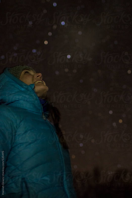 Woman looks up at the stars by Hannah Dewey for Stocksy United