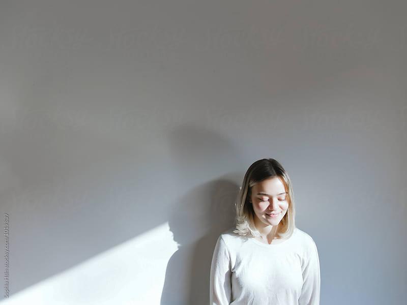 Girl in the Light by Sophia Hsin for Stocksy United