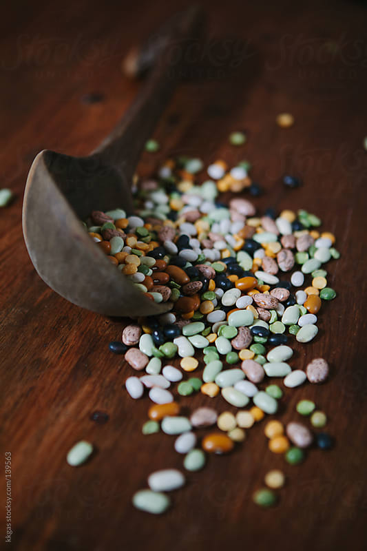 Dried mixed beans and split peas with a wooden spoon. by kkgas for Stocksy United
