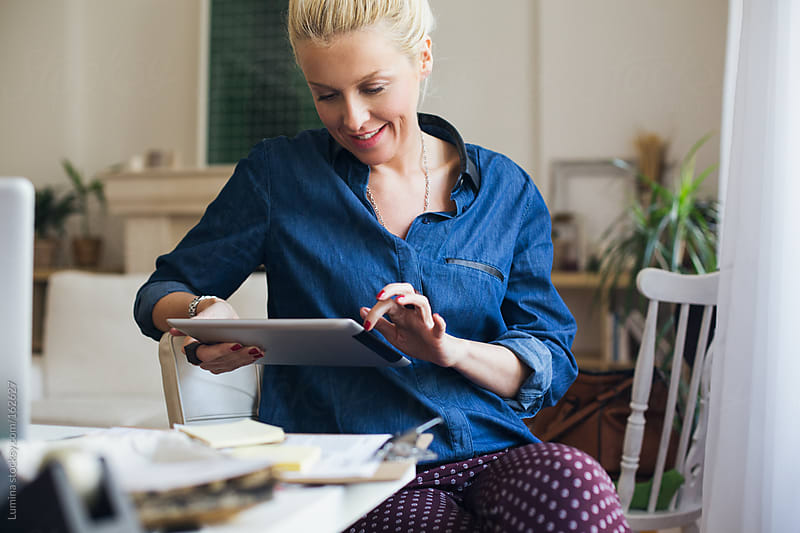Businesswoman Using a Tablet by Lumina for Stocksy United