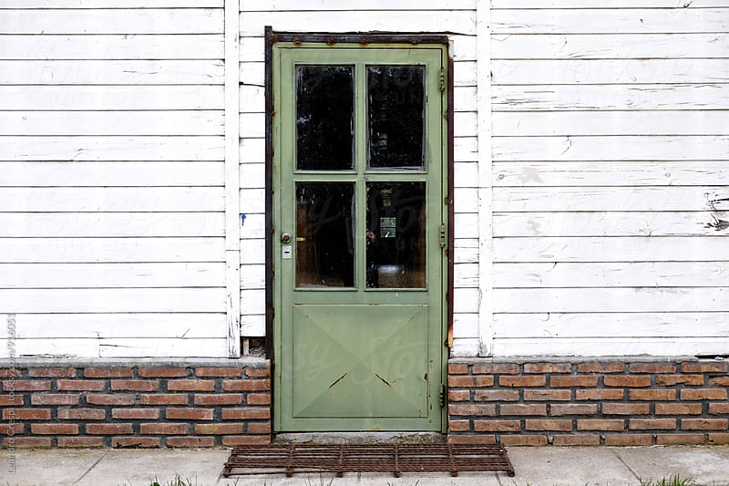 Wooden front entrance of a house in the countryside. by Leandro Crespi for Stocksy United