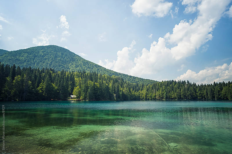 Lake in the Italian Alps by Simone Becchetti for Stocksy United