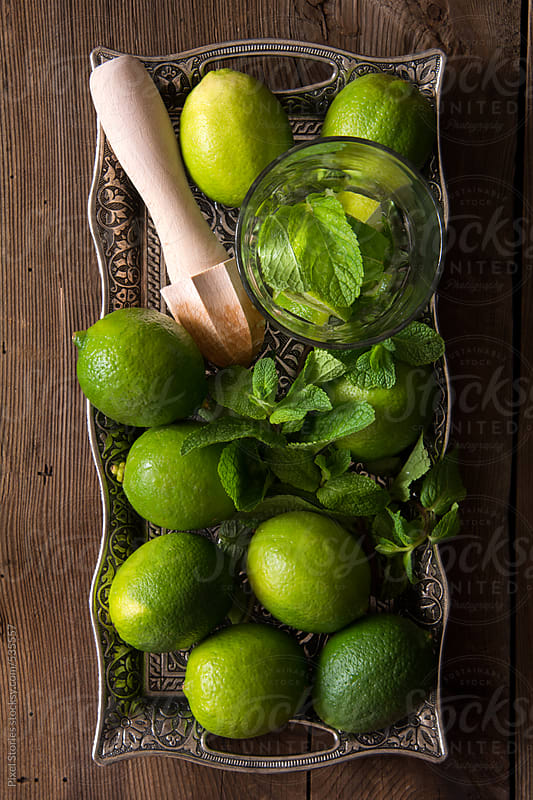 Drinks: making mojito cocktail at home by Pixel Stories for Stocksy United