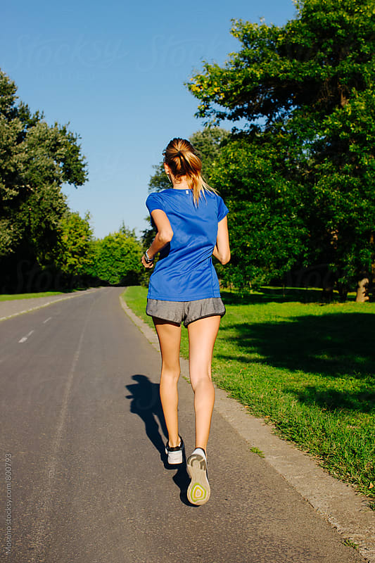Woman Jogging in the Park by Mosuno for Stocksy United