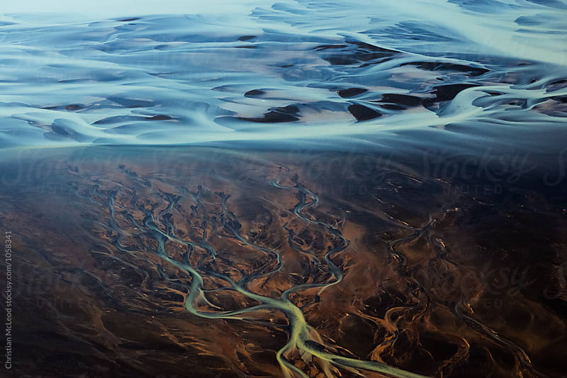 Icelandic glacial river flow by Christian McLeod for Stocksy United