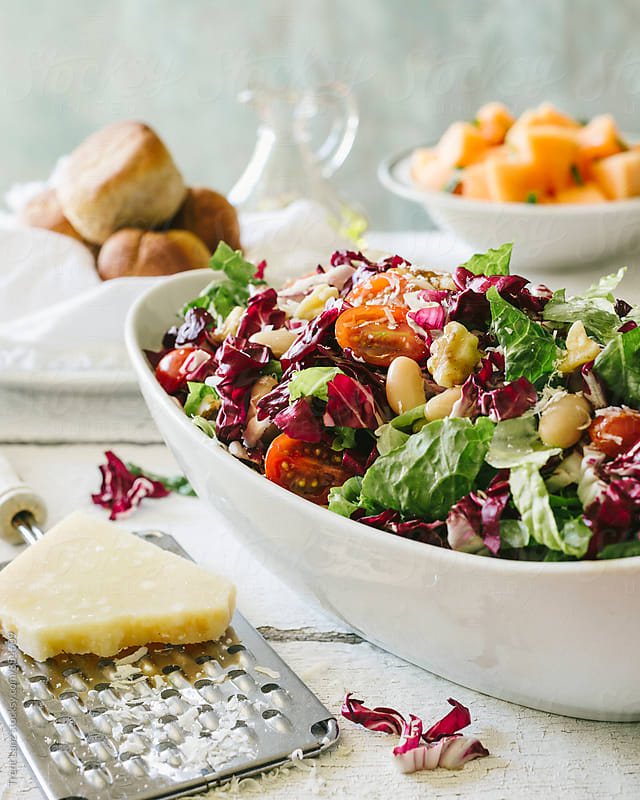 Delicious healthy organic salad and grated cheese by Trent Lanz for Stocksy United