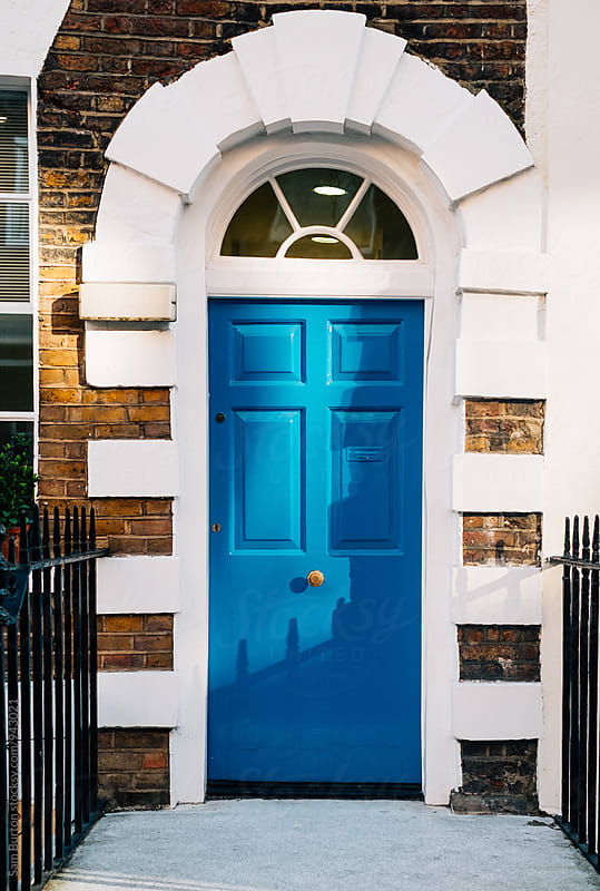 Blue door by Sam Burton for Stocksy United