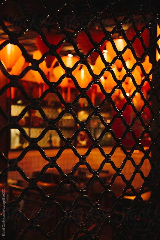 Oriental Restaurant behind Metal Grate by Eldad Carin for Stocksy United