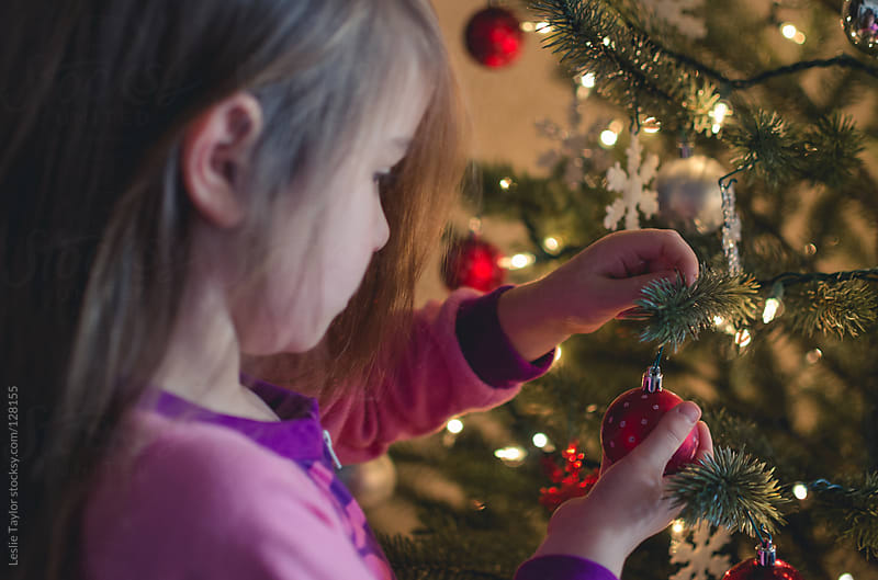 Little Girl Decorating Christmas Tree by Leslie Taylor for Stocksy United