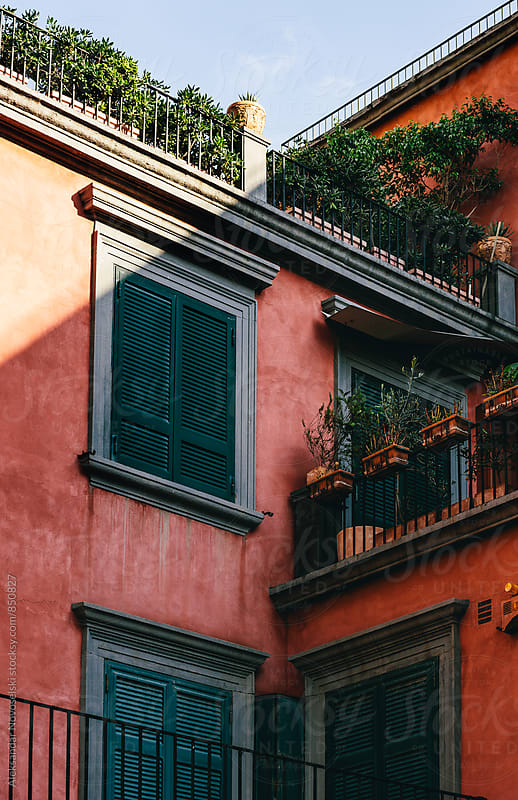 Detail shot of red building in Naples, Italy by Aleksandar Novoselski for Stocksy United