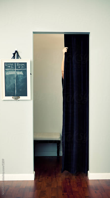 Boutique: Woman Entering Dressing Room by Sean Locke for Stocksy United