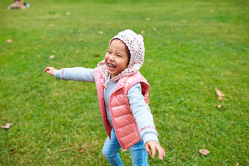 lovely little asian little girl playing outdoor by Bo Bo for Stocksy United