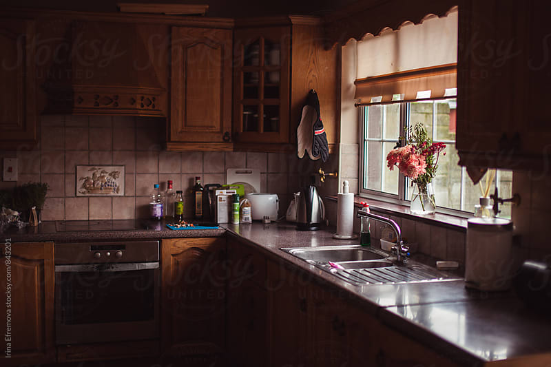Kitchen in a dim daylight on a moody day by Irina Efremova for Stocksy United