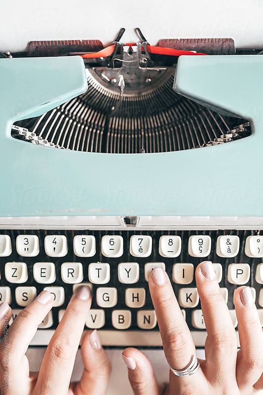 Close up of woman hands writing with a vintage typewriter by Vera Lair for Stocksy United