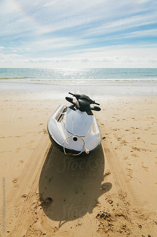 Watercraft Moored on a Sandy Beach by VICTOR TORRES for Stocksy United