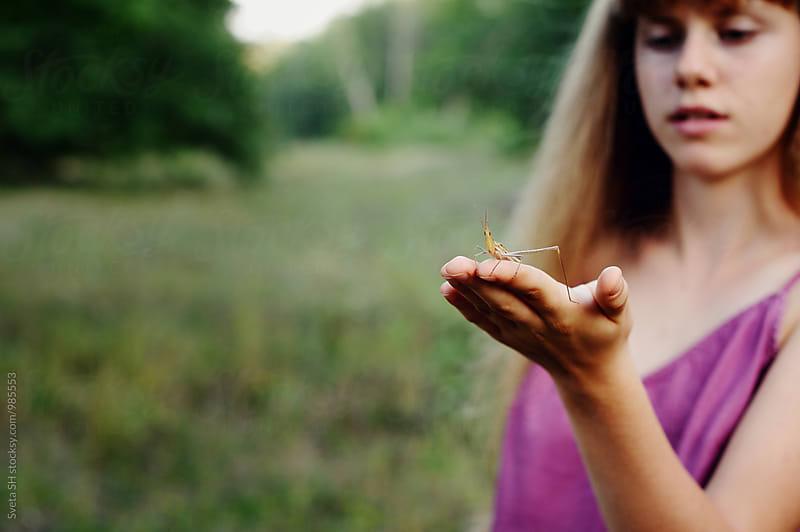 The girl and the grasshopper by Svetlana Shchemeleva for Stocksy United