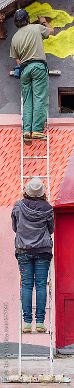 Two graffiti artists on ladder by Pixel Stories for Stocksy United