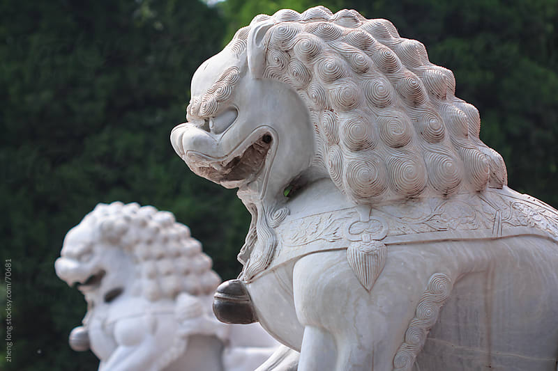 The ancient Chinese stone lions by zheng long for Stocksy United