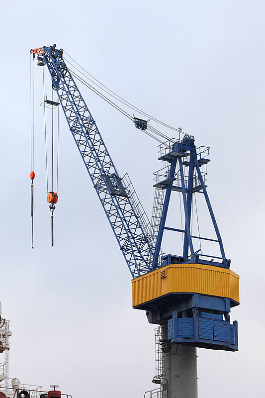 Crane and ship in Hamburg harbour by Marcel for Stocksy United