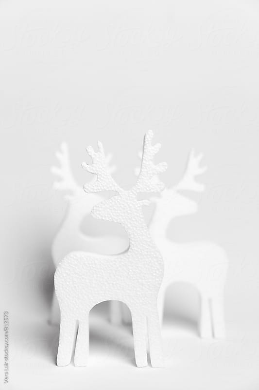 White reindeers by Vera Lair for Stocksy United