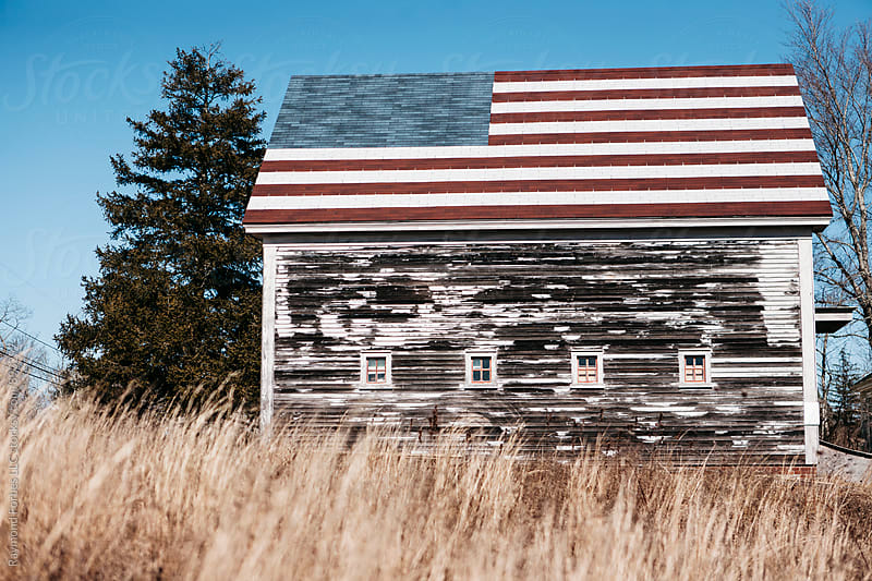 Barn with American Flag  by Raymond Forbes LLC for Stocksy United