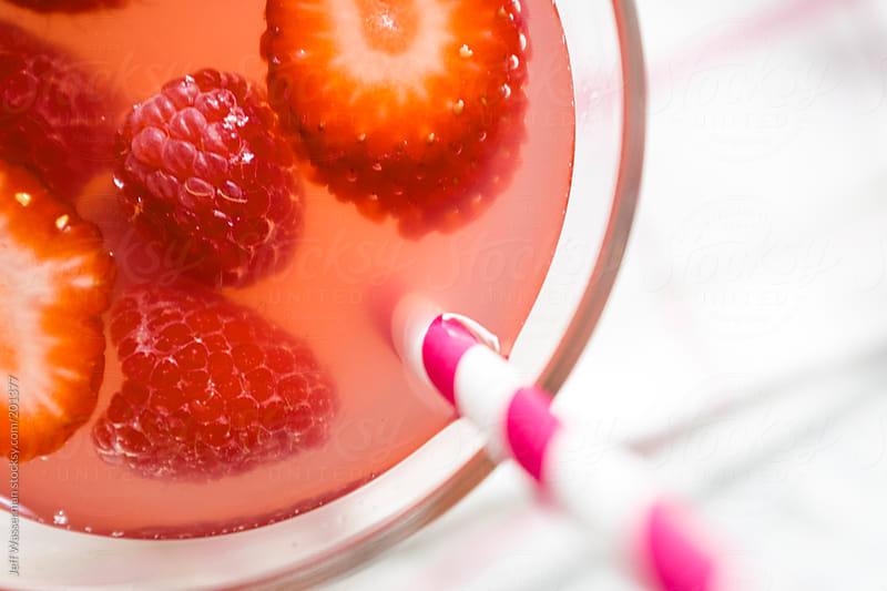 Summer Fruit Drink Including Rasberries and Strawberries by Jeff Wasserman for Stocksy United