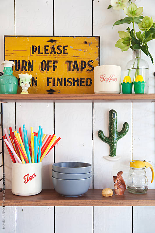 Shelves in a kitchen with fun retro items, bowls and canisters by Natalie JEFFCOTT for Stocksy United