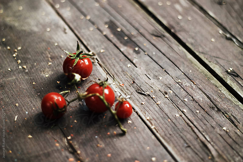 Fresh cherry tomato on wooden table by Jovana Rikalo for Stocksy United