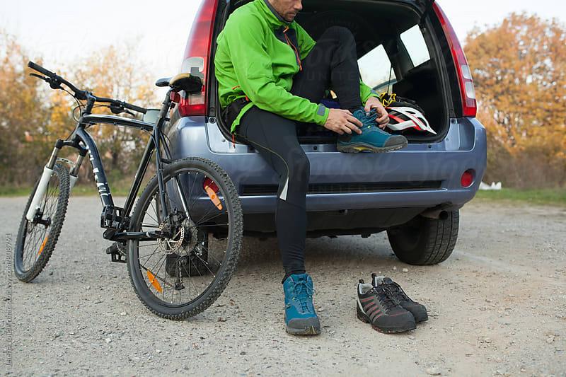 Preparation for mountain bike ride by Jelena Jojic Tomic for Stocksy United