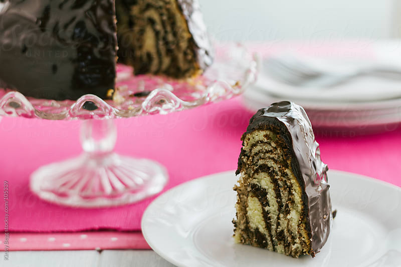 Zebra print chocolate bundt cake horizontal by Kirsty Begg for Stocksy United