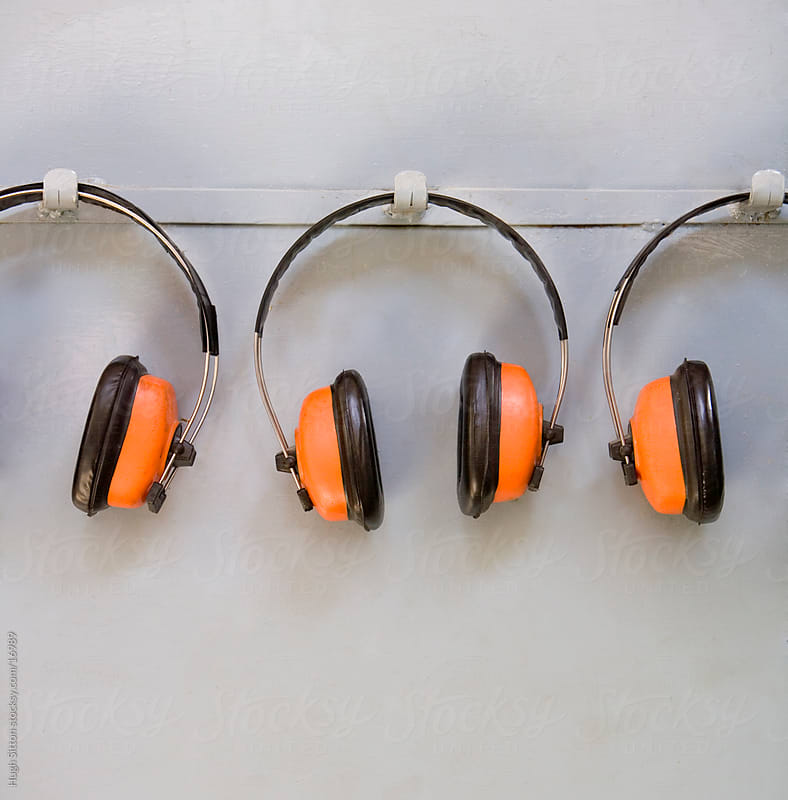 Ear defenders hanging on factory wall. by Hugh Sitton for Stocksy United