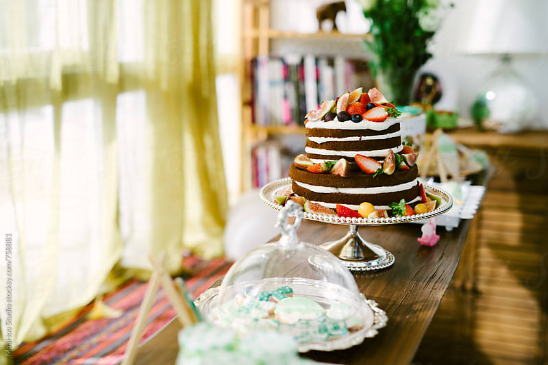 Close up of table with dessert by Maa Hoo for Stocksy United