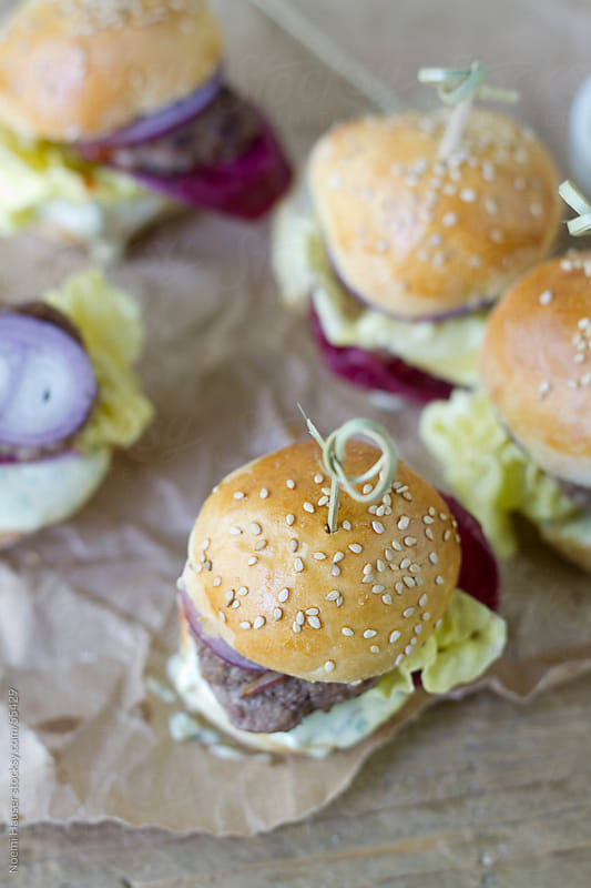 Mini hamburgers from above by Noemi Hauser for Stocksy United