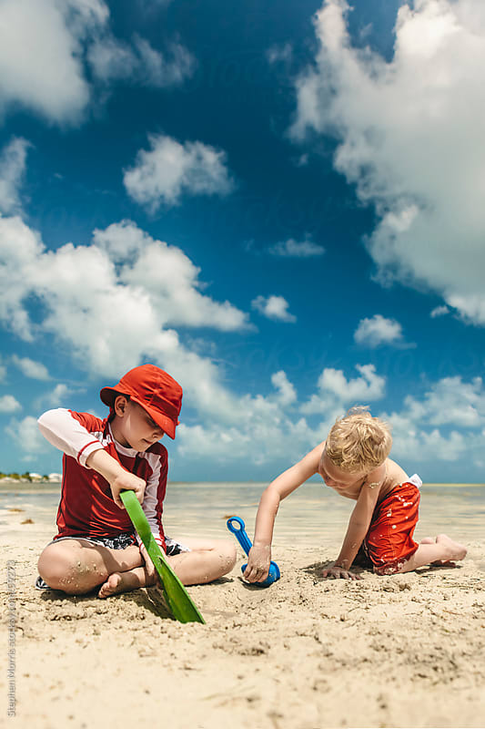Kids Playing on Tropical Beach by Stephen Morris for Stocksy United