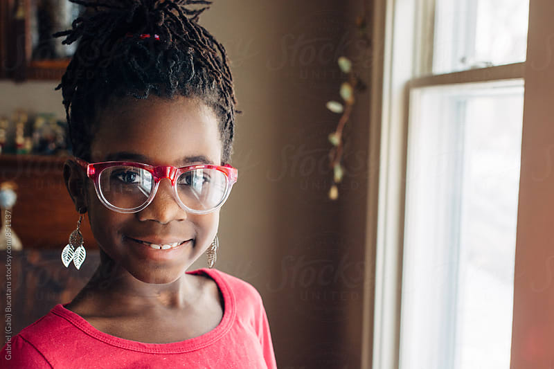Cute black girl wearing glasses by Gabriel (Gabi) Bucataru for Stocksy United