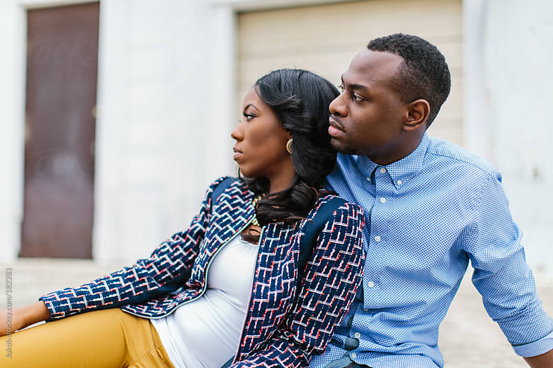 A trendy and stylish African-American being affectionate in an urban setting by Jakob for Stocksy United